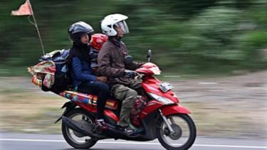 Mudik dengan motor.